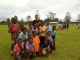Older kids joining in the footy clinic