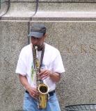 A wailing saxophone street performer