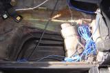Under rear Seat - Driverside
