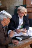 Counting money, Sana'a souq
