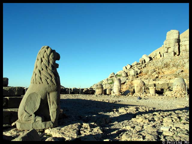 Lion facing the stone heads