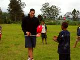 Mel Michael from Essendon (Aussie Rules football) giving a footy lesson