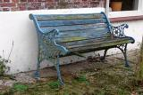 What's left of a blue bench
