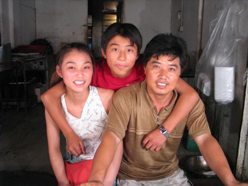 Pretty Shanghai girl with Father and Brother