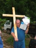 Bill carries the cross