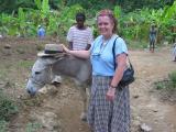 Janic with hat on donkey
