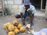 local cutting up coconuts for us