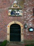 Winsum - Kerkdeur met gevelornament