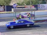 blue drag racer  getting ready to launch