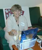 Anita Goodrich sorting pictures.