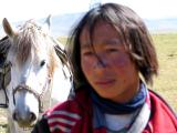 Nomad boy with horse