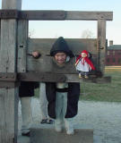Oh,no!  What could this young child and her doll have done to be put in the stocks?  note: the matching hoods!
