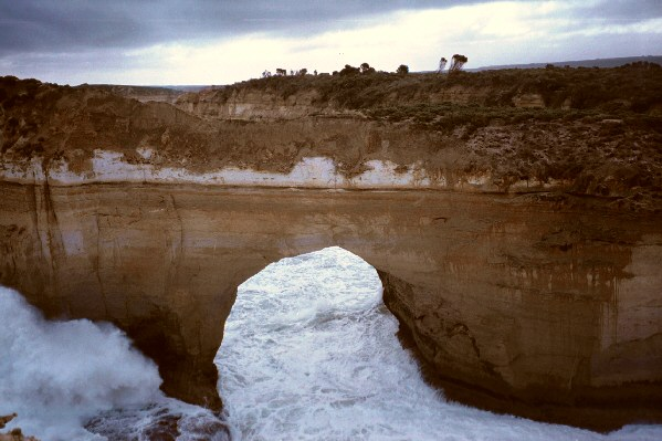 Years of surf and erosion cut a huge hole through this rock