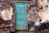 Green door at seaside