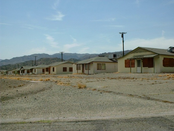 13-houses that are boarded up on the south side of Yucca Dr.