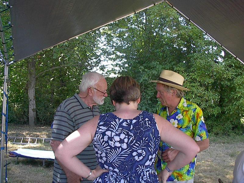 149 John Bogert, Sheila Blech and Doc Miller hold a conference.