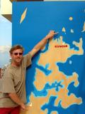 Florian pointing to our starting point, Khasab, and Abu Sir Island, near Kuzmar