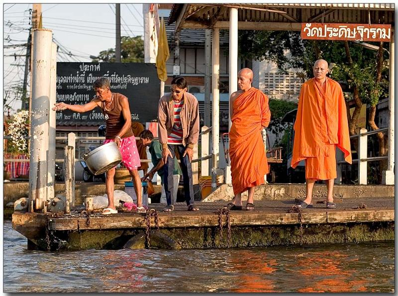 Monks waiting for water taxi
