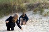 Brigitte and Fleur collecting sand