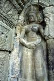 Apsara with lipstick. Ta Phrom temple near Phnom Penh.