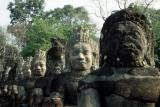 Roadside sentinels, Angkor Thom. Note the reconstuction on some of the heads.