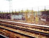 Rusty tracks and a brickwall