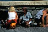 Blonde girl and trinket vendor