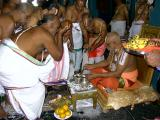 Swamy offering ShreepAda theertham to devotees-2