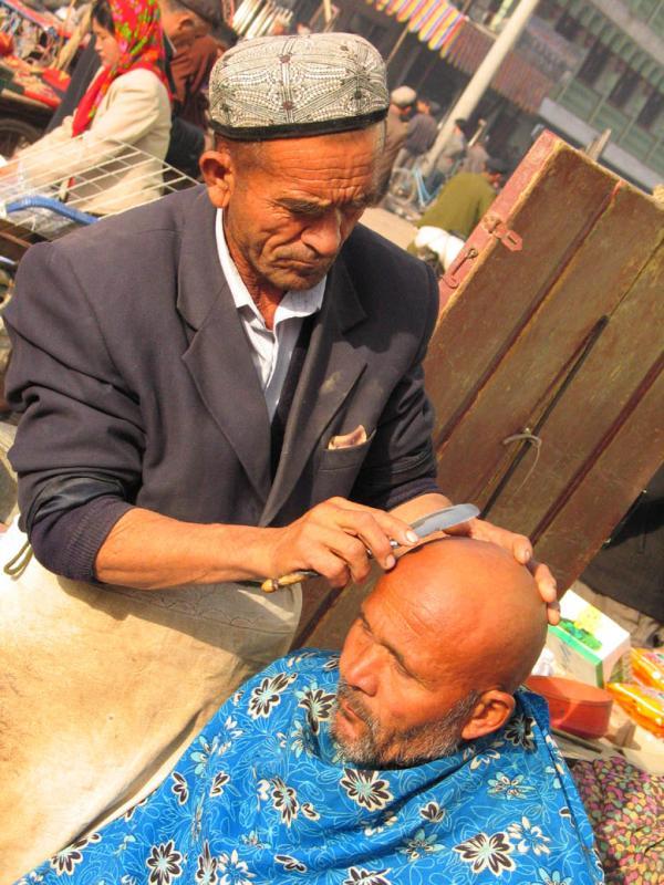 Barber at market