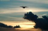Mitsubishi MU-II final approach sunset aviation stock photo