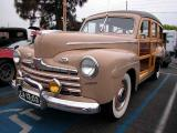 Appears to be 1946, note red striping on grille bars and rectangle park lights. Also front fender chrome is above the sculptured area. A few transition early 1947's had these carry over characteristics