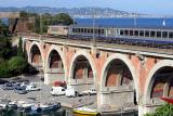 Crossing the viaduc de La Rague over the nice little harbour of Théoule-sur-Mer. In the bottom of the pic, you can see Cannes.