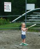What! The sign says nothin about standing on Homeplate!