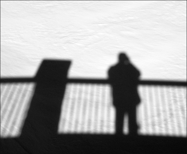 Self-portrait in snow and shadows