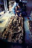 A woodcarver at work in Mandalay.