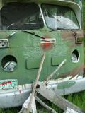 Green Bus Bullet Hole