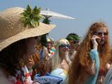 Red Haired Mermaid Communicates Via Sea-Mobile