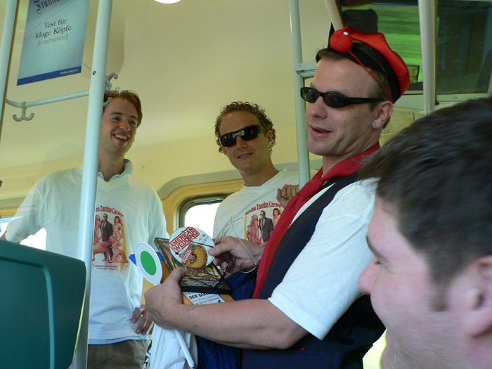 Bachelor party on the train - cute actually, this guys buddies were making him sell random things to get drinking money.