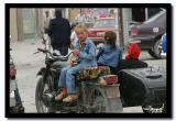 Russian Girl on a Motorcycle at Olgii's Bazaar