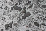 Alternative artform to mudcracks: rocks embedded in glacier ice