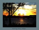 Sunset Train above Ohio River.JPG
