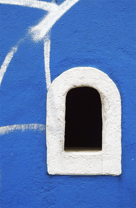 White ticket booth in a blue wall