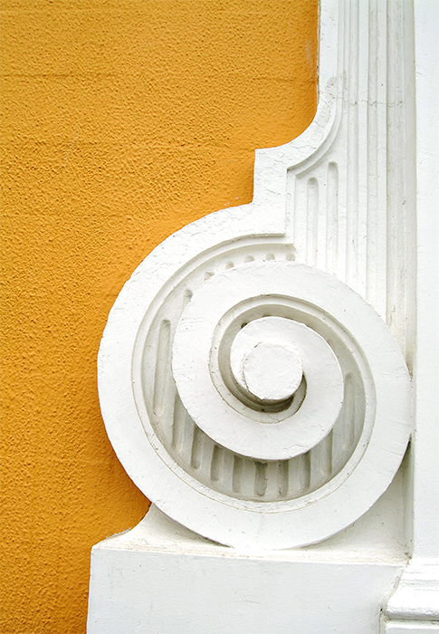 White spiral in yellow wall