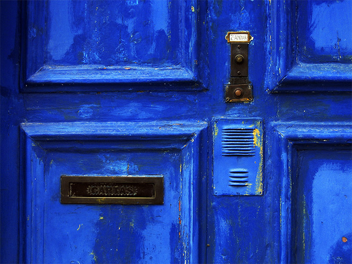 The blue door with the ring and letter box