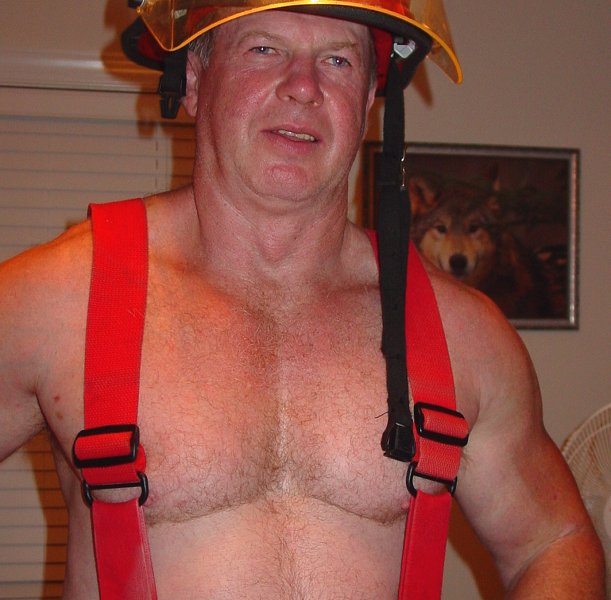 huge muscular firemen posing.jpg
