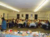GOOD EATS AND CONVERSATION DURING THE POT LUCK AT THE CLUB HOUSE