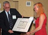 Janie from Microsoft gets an award from the President of the IEEE Computer Society