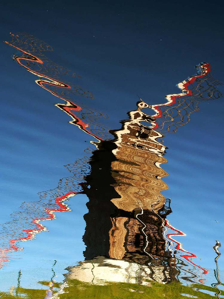 Reflection in water (1): Surreall Windmill, Bruges, Belgium, 2005