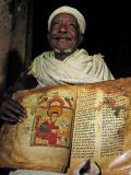 Holding up the ancient book