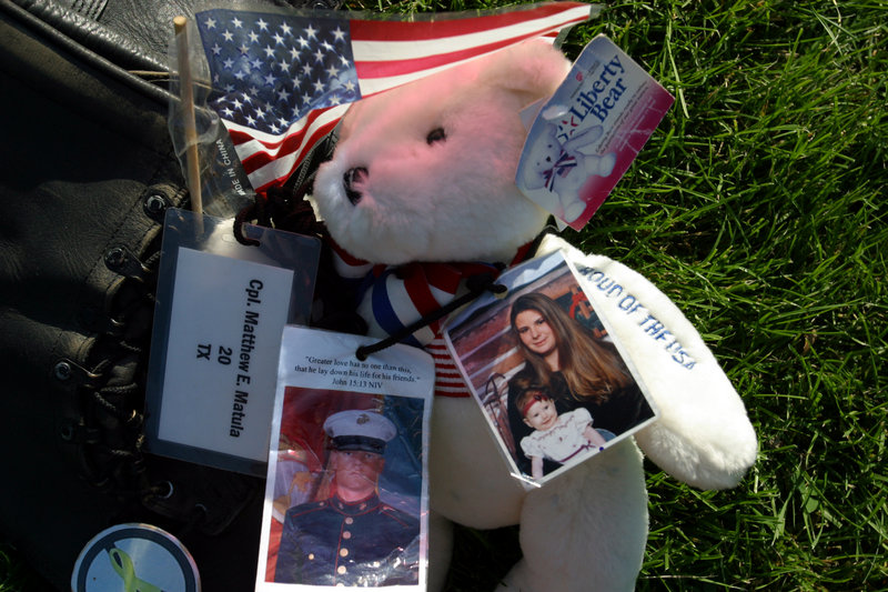 Photos of marine, his widow, and their child